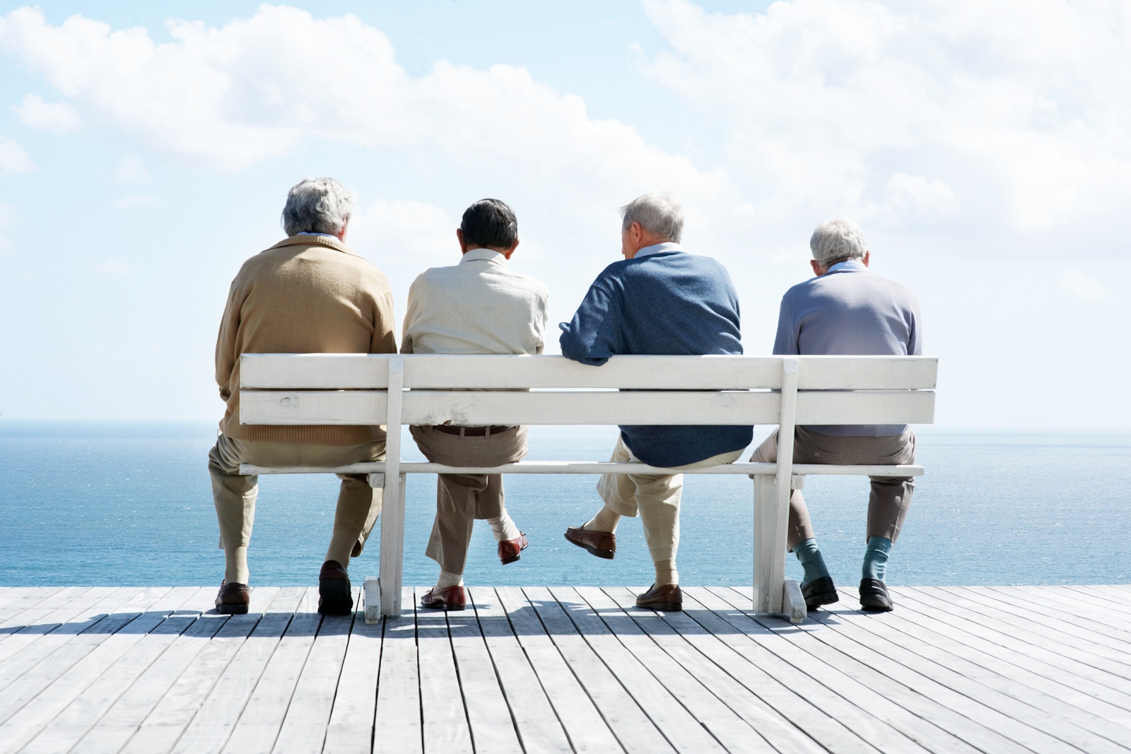 4 old men sitting on a bench