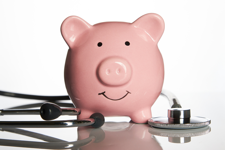 stethoscope around a piggybank